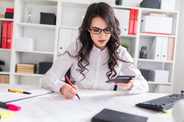 https://thuedungnguyen.vn/wp-content/uploads/2020/05/young-girl-is-sitting-office-desk-working-with-calculator-documents_88135-3259.jpg