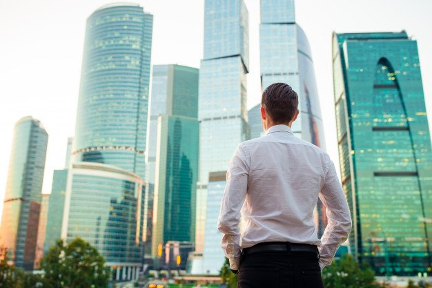 https://thuedungnguyen.vn/wp-content/uploads/2020/07/back-view-businessman-looking-copy-space-while-standing-against-glass-skyscraper_109800-4444.jpg